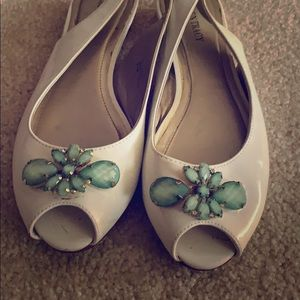White slingback flats with mint jewel accent.